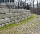 Redi-Rock retaining wall with fence