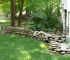 dry stack field stone wall landscape bed